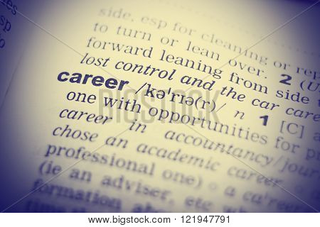 Close-up of word in English dictionary. Career, definition and transcription