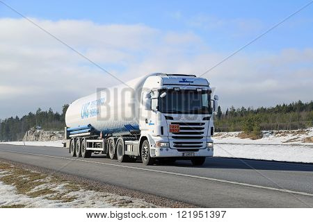 PAIMIO, FINLAND - MARCH 12, 2016: Scania semi tank truck in ADR haul along motorway. The ADR code 223 1972 signifies methane refrigerated liquid or natural gas with high methane content.