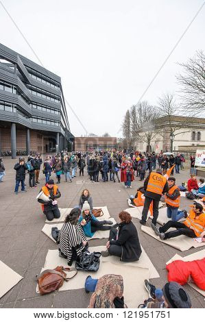 STRASBOURG FRANCE - MAR 15 2016: Die-in protest of hundreds protests against Bas-Rhin Alsace departmental budget cuts for 2016 requesting no cuts and wage increase