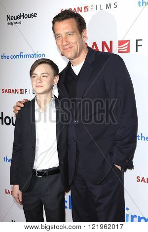 LOS ANGELES - MAR 15: Jaeden Lieberher, Clive Owen at the premiere of Saban Films' 'The Confirmation' at NeueHaus on March 15, 2016 in Los Angeles, California