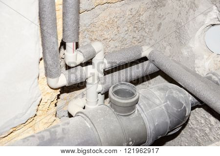 Installing pipes for water supply heating sanitation. Workplace plumbing in construction. Installing plumbing.