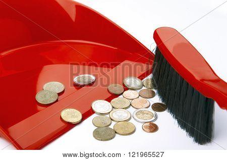 Dustpan brush and eurocent, crisis, concept, closeup
