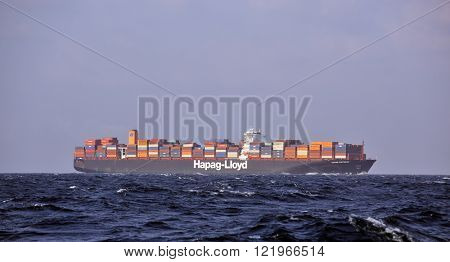 BAB-EL-MANDEB STRAIT GULF OF ADEN  FEB 05, 2016: Hapag-Lloyd Container Ship Ulsan Express in high seas. She has 366m length overall and beam of 48m. Her gross tonnage is 142295 tons.