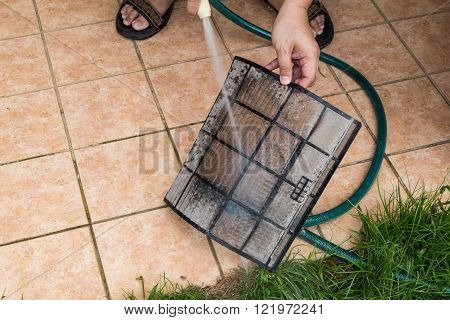 Cleaning Dust Filled Air Conditioning Unit Filters With With Water