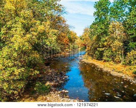 A fall view of Tohickon Creek in Pt Pleasant Bucks County pennsylvania.