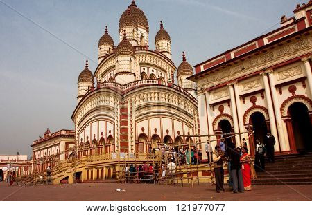 KOLKATA, INDIA - JAN 17: Visitors of the Dakshineswar Kali Temple going to puja at the sunny day on January 17, 2013. The temple was built in nine spires style of Bengal architecture in 1855.