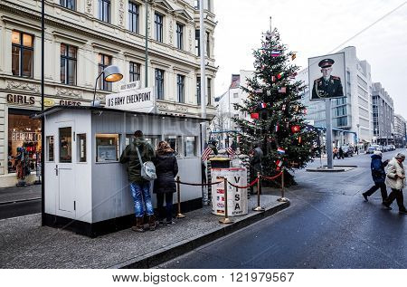 BERLIN, 14 December: Checkpoint Charlie. Former bordercross in Berlin on 14 December, 2014. Berlin Wall crossing point between East and West Berlin during the Cold War. BERLIN, GERMANY