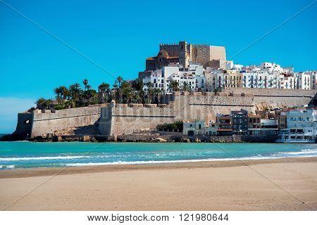 Peniscola castle view from the beach. Costa del Azahar province of Castellon Valencian Community. It is a popular tourist destination in Spain