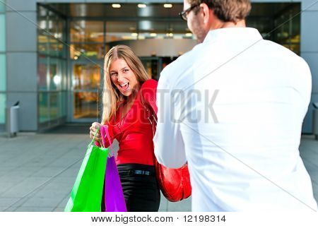 Woman wants to shop into mall, dragging her man or boyfriend to join