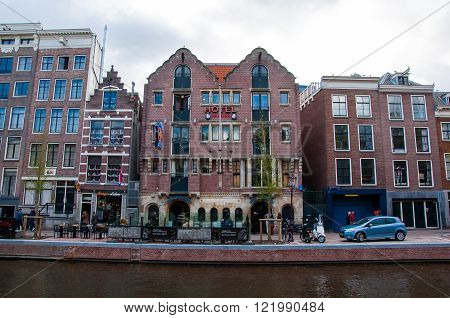 AMSTERDAM-APRIL 30: Famous Amsterdam Bulldog coffeeshop and hotel in red-light district during the evening on April 30 2015 the Netherlands. The Amsterdam Red Light District is one of the most iconic places in all of Europe famous for its liberal laws caf
