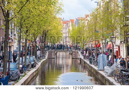 Amsterdam-April 30: Amsterdam Red Light District crowd of tourists go sightseeing on April 302015 the Netherlands. The Amsterdam Red Light District famous for its liberal laws cafes and ladies of the night