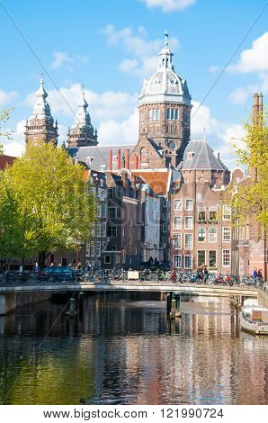 Amsterdam-April 30: Red light district with Church of St. Nicholas on April 302015 the Netherlands.