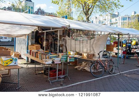 Amsterdam-April 30: Flea market on Waterlooplein merchants display their bric-a-brac for sale on April 30 2015 the Netherlands.