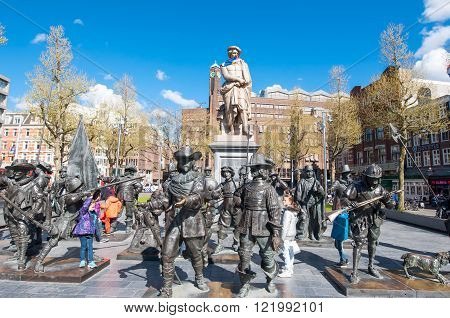 Amsterdam-April 30: Rembrandtplein (Rembrandt Square) with a bronze-cast representation The Night Watch by Russian artists Mikhail Dronov and Alexander Taratynov on April 30 2015 the Netherlands.