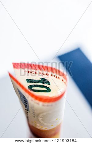 Ten Euro paper currency wraped in tubular shape