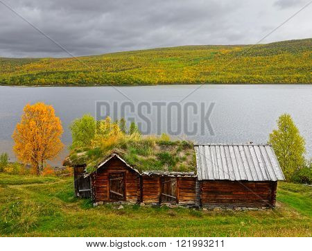 ancient sami house near a lake, utsjoki finnish lapland