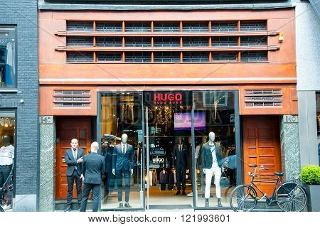 AMSTERDAM-APRIL 30: Hugo Boss store on the P.C.Hooftstraat shopping street on April 302015 in Amsterdam. The German luxury fashion and style house was founded in 1924 by Hugo Boss.