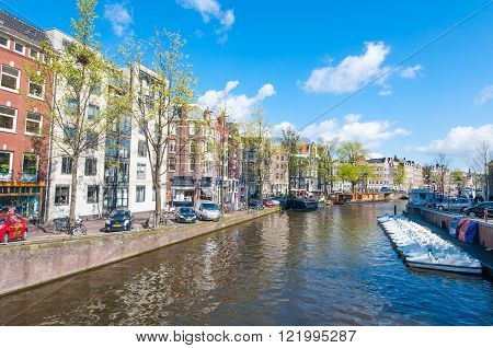 AMSTERDAM-APRIL 30: The Prinsengracht canal (Prince's Canal) on April 302015. Prinsengracht is the third and outermost of the three main canals: Herengracht Prinsengracht and Keizersgracht.