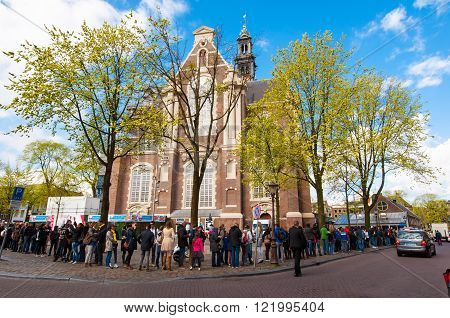 AMSTERDAM-APRIL 30: People stand in a queue to visit the Anne Frank House Museum on April 302015.The Anne Frank House Museum is one of Amsterdam's most popular and important museums opened in 1960.