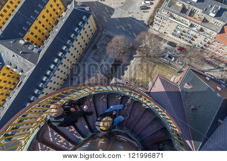 Tourists on top of Vor Frelsers Kirke in Copenhagen, Denmark