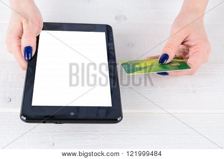 Woman Enters Credit Card Details A Tablet Pc