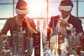 two business persons are developing a project using virtual reality goggles. the concept of technologies of the future poster