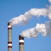 the industrial chimneys emits toxic pollutants into the sky polluting the environment poster