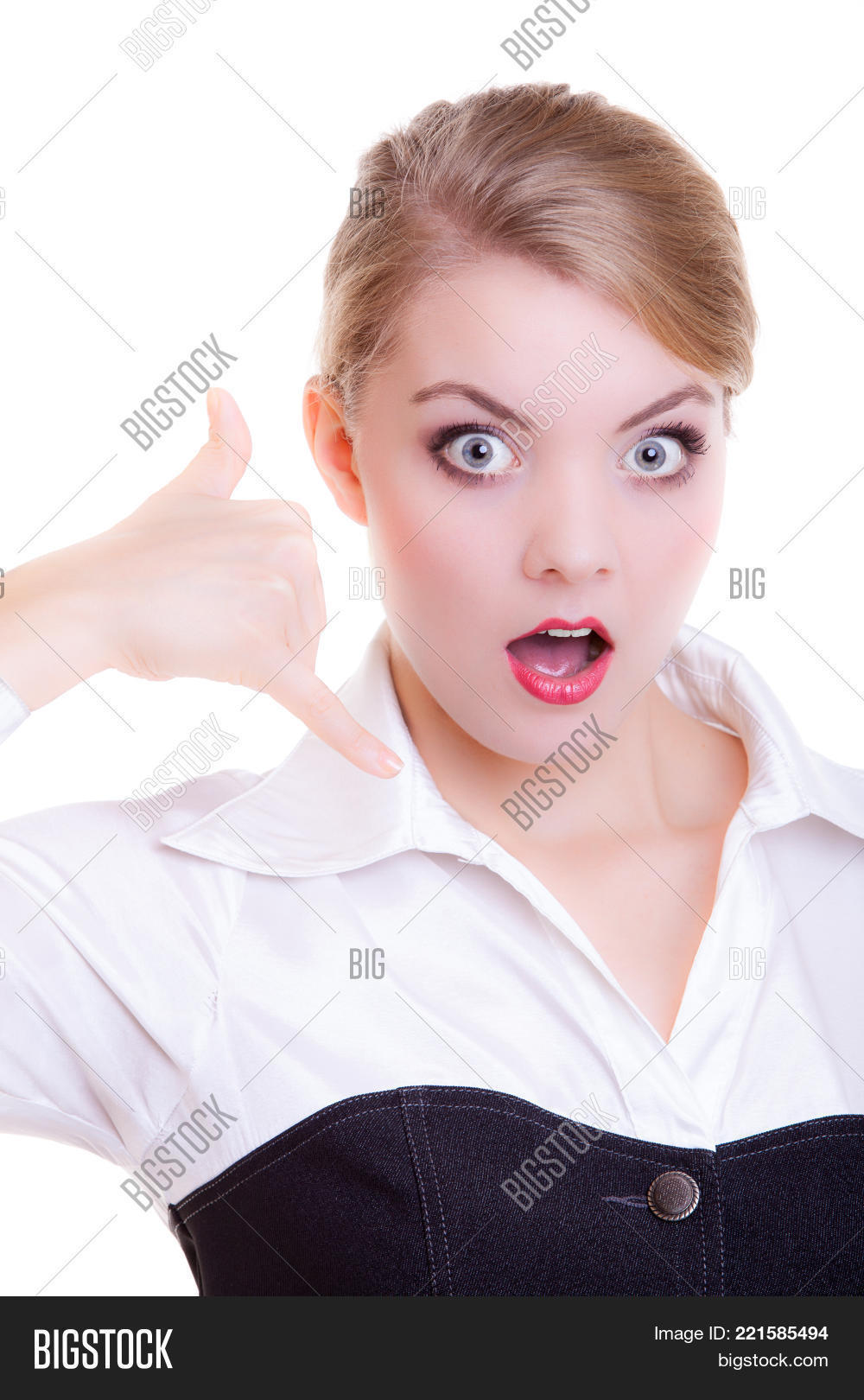 Attractive businesswoman with eyes and mouth wide open making call me  gesture. Surprised blonde girl