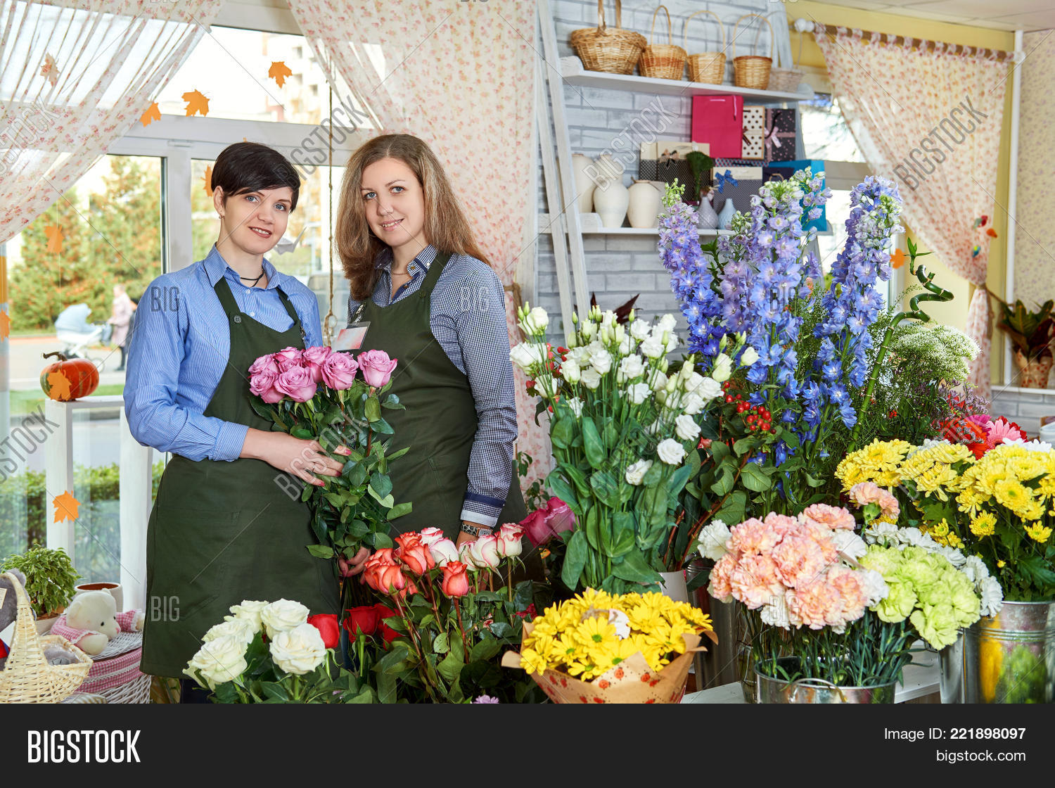 Women flower sellers image photo free trial bigstock women flower sellers two attractive young women working in flower shop and enjoying in beautiful izmirmasajfo