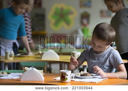 Belarus, the city of Gomel on September 14, 2017.Boy child does not want to eat. Bad appetite. Eating in kindergarten