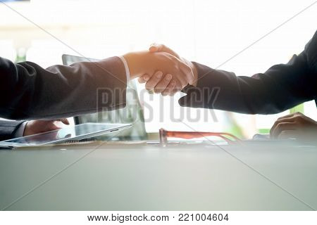 Business Partnership concept. Closeup business shaking hands finishing up a meeting,acquisition concept.