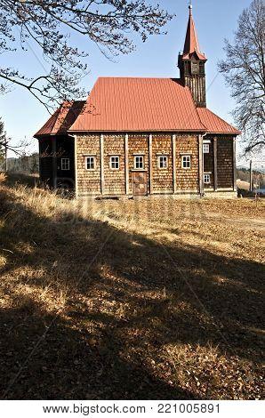 wooden church from 19th century on Grun with clear sky in Moravskoslezske Beskydy mountains in Czech republic