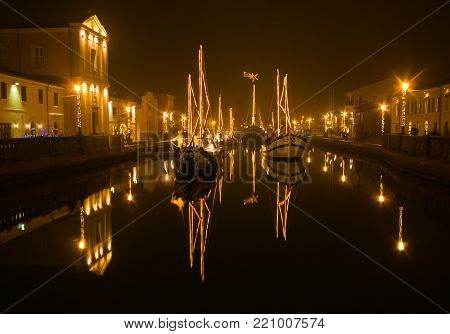 CESENATICO, ITALY - JANUARY 6, 2018: Enchanted atmosphere at the Christmas nativity scene in boats of Cesenatico, Emilia-Romagna, Italy