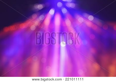 abstract multi-colored light background with defocused bokeh light, the stage of the entertainment show.
