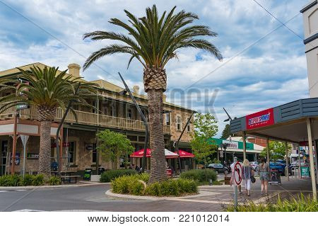 Victor Harbor, Australia - November 11, 2017: Main street with palm trees and historic architecture