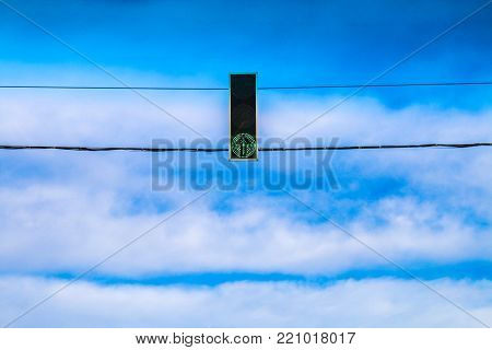 Three Red Traffic Lights Hang Over The Road Against The Blue Sky. Prohibition Signal.