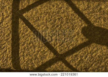 Orange wall stone grunge background, rock texture with shadow