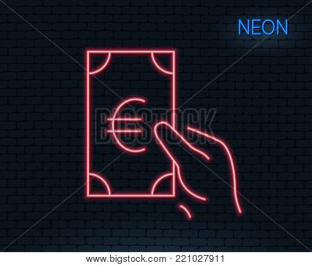 Neon light. Hold Cash money line icon. Banking currency sign. Euro or EUR symbol. Glowing graphic design. Brick wall. Vector