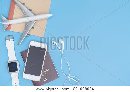 Travel gadget and object on blue copy space for poster and banner