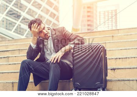 Unemployed businessman stress sitting on stair, concept of business failure and unemployment problem, work life balance, image processing instagram vintage color. poster