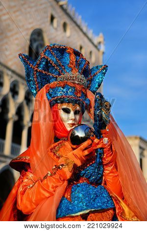 VENICE, ITALY - FEBRUARY 26: Venice Carnival Mask with mirror ball and Doge Palace in the background February 26, 2017 in Venice, Italy