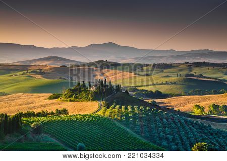 Scenic Tuscany landscape with rolling hills and valleys in golden morning light, Italy