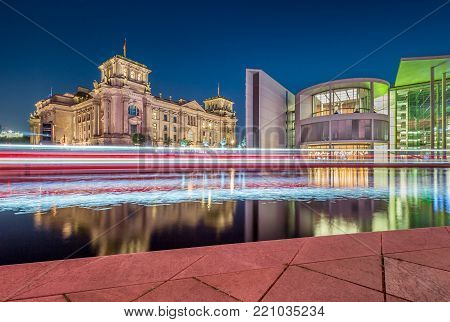Panoramic view of Berlin government district with famous Reichstag building, seat of the German Parliament (Deutscher Bundestag), and Paul Lobe Haus in twilight during blue hour at dusk, Berlin, Germany
