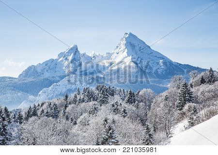 Classic view of famous Watzmann mountain summit on a beautiful cold sunny day with blue sky and clouds in winter, Nationalpark Berchtesgadener Land, Bavaria, Germany
