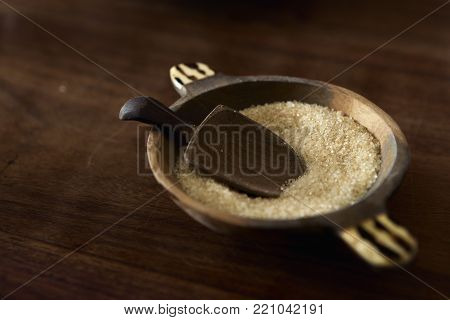 Cane Sugar With Wooden Spoon In Sugar Bowl Wooden Table