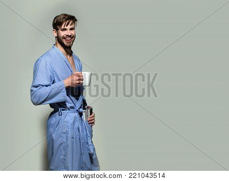 Happy Man In Dressing Gown Smile With Cup And Magazine