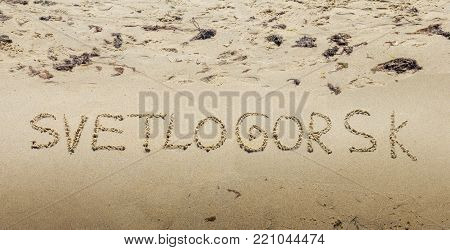 Inscription on wet sand Svetlogorsk. Kaliningrad region. Russia
