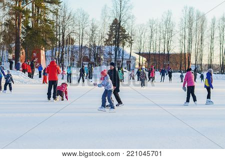 NIZHNY TAGIL, RUSSIA - JANUARY 29, 2017: Mass skating on the rink under the open sky on a winter evening