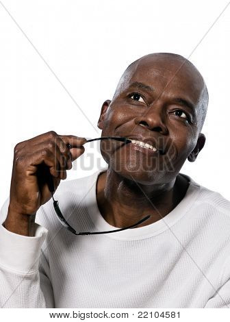 Close-up of a contemplative afro American man looking up in studio on white isolated background