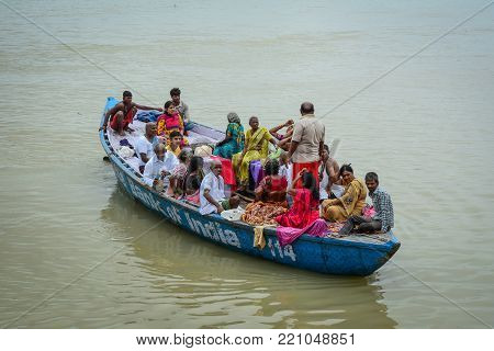 Varanasi, India - Jul 12, 2015. Tourist boat on Sacred Ganges River in Varanasi, India. Varanasi is the holiest of the seven sacred cities (Sapta Puri) in Buddhism, Hinduism and Jainism.